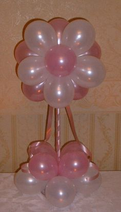 Balloon flower centerpiece in pink and white. Ideal for a baby shower or girl's birthday.