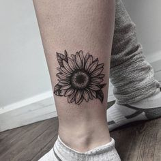 25 The minimalistic sunflower tattoo on the ankle for men