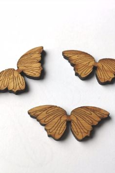 This cute larger style of butterfly features two wings with intricately etched pattern, joined by a thin beam at the centre where you attach to your garment. #BeyondMeasure #wooden #button Largest Butterfly, Costa Rica, Beams, Arrow, Larger, Centre, Bamboo, Wings, Buttons