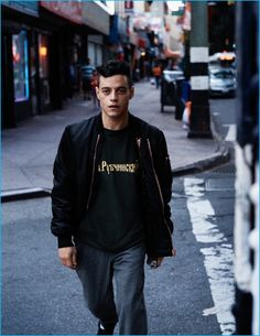 Rami Malek goes casual in a Givenchy bomber jacket, worn with a Gosha Rubchinskiy t-shirt, Comme des Garçons pants and Reebok sneakers.