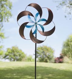 """Two-Tone Pinwheel Metal Garden Spinner --   •  2 separate Kinetic spinners in different metal tones • Blue center adds visual interest  •  20"""" dia. x 6-1/4""""D x 67""""H  --  $70"""