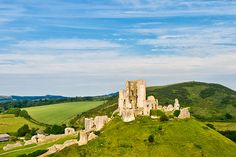 Corfe Castle's walls are rife with tales of treason and treachery. Corfe Castle, Castle Wall, About Uk, Monument Valley, Places Ive Been, Tours, Activities, Adventure, Halloween