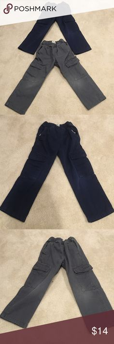 Boys Children's Place cargo pocket pants The boys Children's Place cargo pants are a size 5t. One pair is navy and the other pair is gray. There are two side pockets and two cargo pockets located on the side of the pants. Children's Place Bottoms
