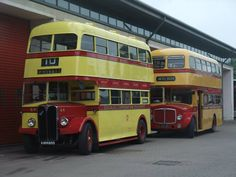 Preserved Douglas AEC Regent III 64 (KMN 835) is seen at Banks Circus depot, Douglas on July 17th 2014 while taking part in a road run to commemorate 100 years since the start of Douglas Corporation's bus service. Behind 64 is 410 LMN, the last ever AEC Regent V to be produced. Photo copyright Thurstan Denne.