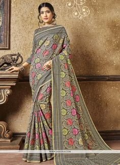 Everyone will admire you when you wear this clad to elegant affairs. An outstanding grey banarasi silk designer traditional saree will make you look very stylish and graceful. The brilliant attire cre...