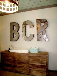 Love these letters! They would look great against a navy wall and they sell them at Scotts.