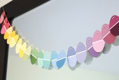 Paint Chip Easter garland - so cute!! would be really neat in the nursery or dining hall w/ two words Easter means to each member.