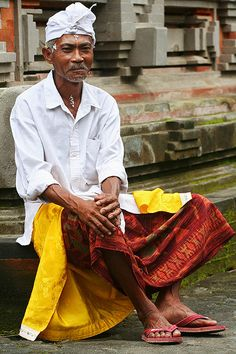 An elder member of the village, resting before a Hindu ceremony at Tampaksiring, Bali