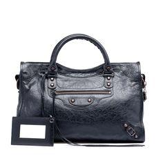 BALENCIAGA City bag  http://www.balenciaga.com/en_US/shop-products/accessories/women/handbags/classic/balenciaga-city_804642832.html