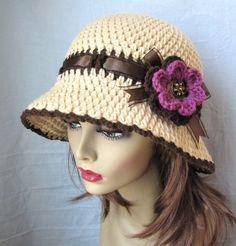 Chic. Fashion. Womens Hat. Beige Cloche. Adults or Teens. Grape Purple. Brown. Hand-crocheted with acrylic yarn, embellished with ribbon tied into a bow and a crochet flower. The ribbon is secured and cannot be undone. The ends of ribbon are treated so they will not fray. The brim is malleable so you can style the hat (Flapper or Cloche) or any way you want. Makes unique wonderful gifts. SPECIFY SIZE. Other sizes are also available. Please request for it.    COLOR (S):  Hat: Heather Beige…