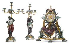 An Orientalist style cold painted and polychrome decorated metal three piece clock garniture<br>France, late 19th century | Lot | Sotheby's