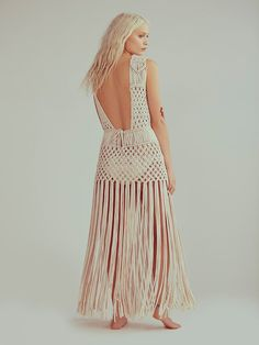 Labyrinth Dress | Made from a luxe macramé this beautiful sheer sleeveless dress features allover metal ball accents, a statement low back and dramatic fringe trim.  Pair with one of our Signature Seamless styles for an effortless look.