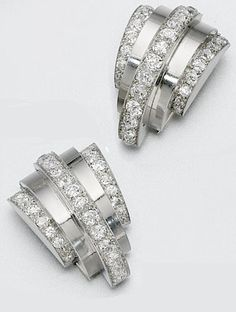 Pair of platinum and diamond clips, René Boivin, circa 1933. The semi-circular arches decorated with bands of old European-cut diamonds, unsigned, French assay marks. Together with a letter of authenticity  from Francoise Cailles (dated February 14, 2005) stating that the clips were made by Boivin.