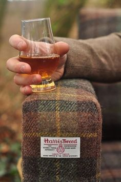 Prima Ivy: Harris Tweed upholstered armchair, glass of scotch.