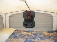 Rangement additionnels lit suspendus de tente-roulotte