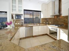 Granite in a kitchen design from an Australian home - Kitchen Photo 1476470 Benchtops, kickboard and splash back all the same ... too much or coordinated??