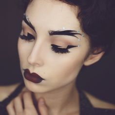 Graphic brows and liner with vampy lips and face jewelry by lupescuevas on Instagram.