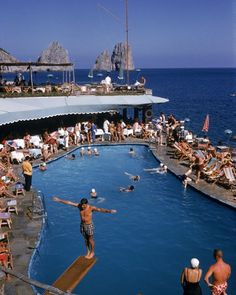 """@classgoldenera shared a photo on Instagram: """"Blue dreams. ⠀⠀ In this classic summer scene in Canzone del Mare on the Piccola Marina in Capri, holiday-makers gather in the renowned…"""" • Aug 8, 2020 at 2:09pm UTC Palm Beach, Miami Beach, Slim Aarons, Richard Neutra, Beautiful Pools, Most Beautiful Beaches, Beautiful Places, Saint Tropez, Algarve"""