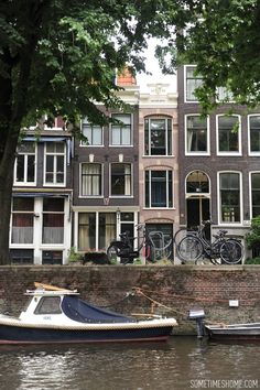 10 things to do in Amsterdam besides smoke pot by travel blog Sometimes Home. View of the canals and row houses from the street.