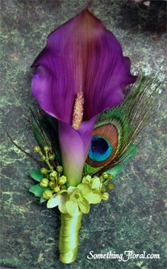 Realistic, artificial/faux, purple calla lily and peacock feather boutonniere…