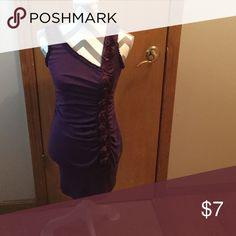 Plum colored form fitting dress Wide banded at the bottom. Polyester/rayon/spandex. Delicious Dresses