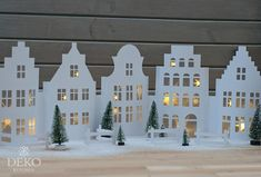 DIY: Christmas window decoration with a pretty row of houses made of paper - Weihnachten Christmas Window Decorations, Paper Decorations, Holiday Decor, Christmas Art, Christmas Ornaments, Paper Houses, Christmas Inspiration, Diy And Crafts, Paper Crafts