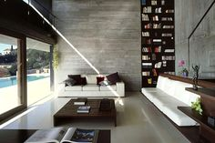 Great open space and love the raw cement/bookshelf wall