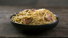 Recipe with video instructions: Creamy, classic carbonara doesn't need to be complicated to be delicious. Ingredients: 4 oz (110g) spaghetti, 2 oz (50g) guanciale, Olive oil, 1 cup pecorino Romano, grated, 2 egg yolks, Black pepper