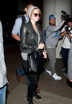 Jennifer Lawrence gave airport style the cool-girl treatment in a pair of black jeans and a green moto jacket.                   Image Source: Getty / GVK/Bauer-Griffin