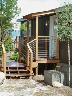 A Modern Double Wide Remodel - Mobile and Manufactured Home Living Yep this would look very nice off of our mud room. Mobile Home Porch, Mobile Home Exteriors, Mobile Home Renovations, Mobile Home Living, Remodeling Mobile Homes, Home Remodeling Diy, Home And Living, Mobile Home Steps, Modern Mobile Homes