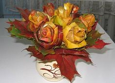 This is cool. How to make roses from folded-up fall maple leaves. Pretty cool stuff.