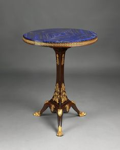 Krieger (Maison) A Fine Empire Style Gilt-Bronze Mounted Mahogany Gueridon With a Lapis Lazuli Top  French, Circa 1900.