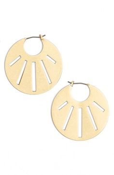 LOVE these Madewell 'Rose' Cutout Hoop Earrings at Nordstrom. Geometric cutouts radiate across these modern hoop earrings plated in a warm antiqued finish.