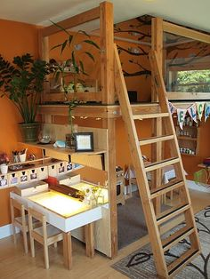 Nice use of the loft, with the shelves and light table against it.