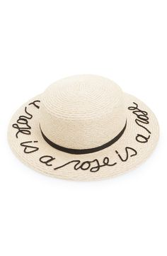 "Raised script spells out, ""a rose is a rose is a rose"" along the neat brim of this fun hat that is perfect for keeping the sun off the face."