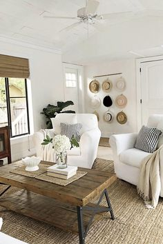 """Kay Volmar who renovated her 1912 Florida cottage on a dime gave us the best tip for filling a blank wall without a high price-tag: Hang all your hats together in one grouping!"""" #farmhousedecor #southernliving #homedecor"""