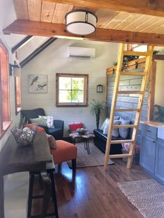 This is the Highland Tiny House on Wheels by Incredible Tiny Homes. It features a thatched roof and impressive wide by long dimensions! Tyni House, Tiny House Living, Small Living, Home And Living, Living Spaces, Living Room, Tiny House Plans, Tiny House On Wheels, Murphy Bed Plans