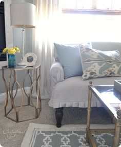 Worlds Away gold leaf end table from One Kings Lane.  Thrift store coffee table.  Ikat pillow from PB.  Lattice rug from World Market.