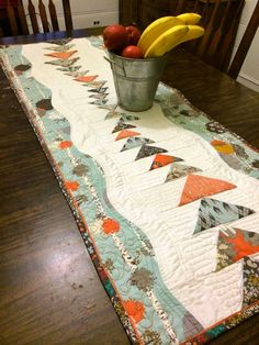 "Fabric of My Life: Indelible Migration table runner... This table runner is really fun to make, somewhat improvisational and much easier than it really looks! This table runner finished at 20""x 54"" but both length and width are easily changed by either changing the number of Flying Geese blocks or varying the width of side borders."