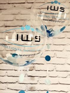 White and shades of blue confetti with matching strings branded with IWS (International Water Solutions) logo