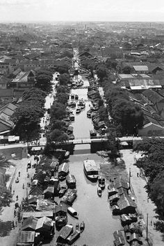 Even without photographic evidence, it's a safe bet that 1955 Saigon was a world apart from the frantic energy of today's mammoth metropolis. ...
