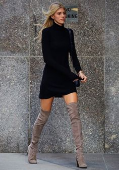 Try a black turtleneck sweater and a beige over the knee boot. Legs for days!