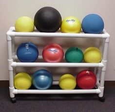 medicine ball storage out of PVC pipe Pvc Storage, Ball Storage, Garage Storage, Storage Racks, Storage Room, Home Gym Equipment, Camping Equipment, No Equipment Workout, Basement Gym