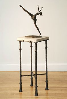 Whimsical bronze sculpture.