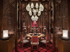 Transport yourself to ancient China for a Yunnan feast within ornate carved wood walls inspired by the region's traditional architecture at Grand Hyatt Lijiang.