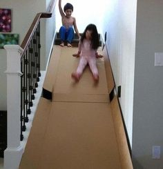 18.) Use a sturdy, cardboard box to make a slide on the stairs.