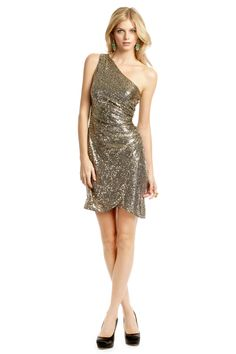 0b1e3db2d5b0 Sparkle all night long in this Trina Turk Gold Tulip Dress! We love the  shape of the dress.