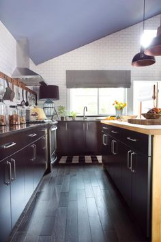 Black cabinets provide a dramatic contrast against bright white subway tile for a classic color combination.