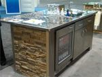 Home bar design plans that incorporate faux stone bring together a functional, modern bar.