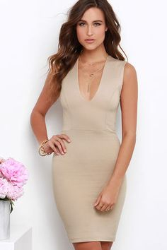 In the Love the Limelight Beige Dress, you'll always be the center of attention! This stretch knit number has a princess-seamed bodice, with sleeveless style and a deep V-neckline. Bodycon skirt takes over at the waist, and drops to a perfectly modest length. Exposed gold zipper on back. Unlined. 62% Viscose, 33% Nylon, 5% Spandex. Dry Clean Only. Made With Love in the U.S.A.